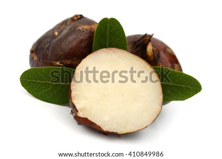 whole and peeled Chinese water-chestnut or water-nut on white background - stock photo