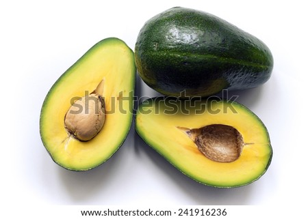 whole avocado with two halves isolated on white