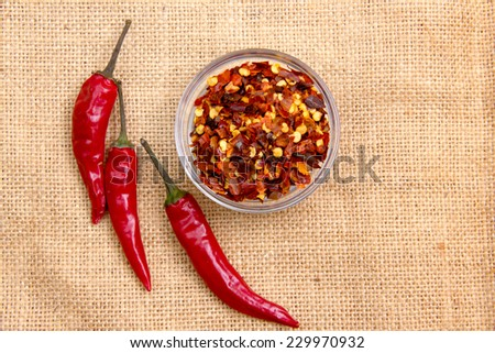 Whole chillies and jute mat on the ground when viewed from above - stock photo