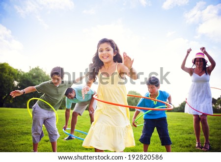 Whole family hula hooping outdoors.