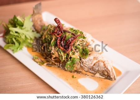 Whole fish in red curry sauce