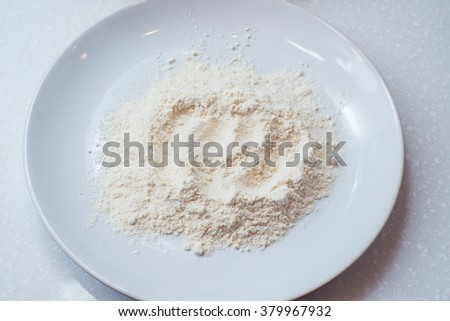 Whole flour in bowl on white background for frying - stock photo
