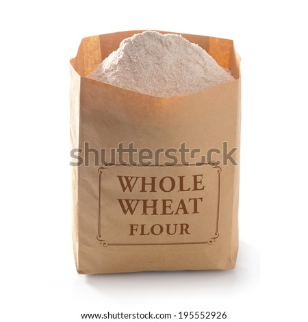 Whole flour in brown craft paper bag on white background - stock photo