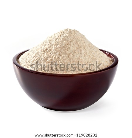 Whole flour in wooden bowl on white background - stock photo