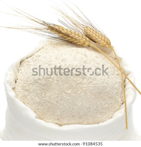 Whole flour with wheat ears on white background - stock photo