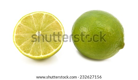 Whole fresh lime and cut half fruit, isolated on a white background