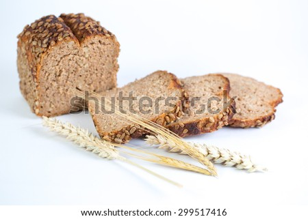Whole grain bread with sunflower on white background