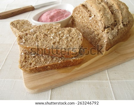 Whole grain bread with vegetable spread from beetroot and horseradish - stock photo