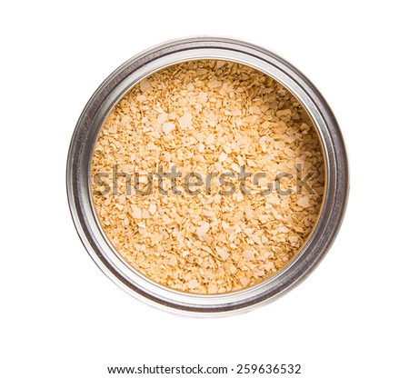 Whole grain breakfast cereal in a aluminum can over white background - stock photo