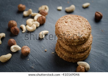 stock photo whole grain cereal shortbread biscuits cookies stacked on black slate with cashew and hazel nuts 410169046 Ginger And White Coffee Three Biscuits Stock Photo Image