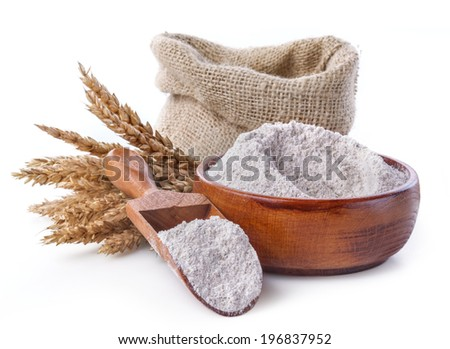 whole grain flour in a bowl and linen bag with a wooden spatula - stock photo