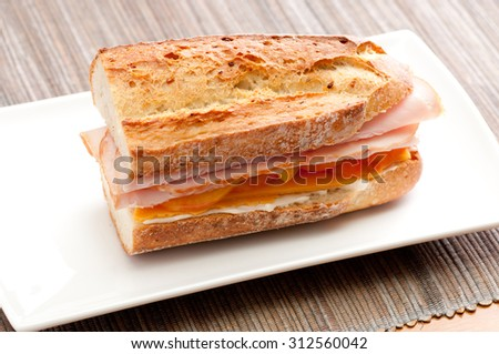 Grilled sandwich or panini with melting cheese, tomato, and spinach ...