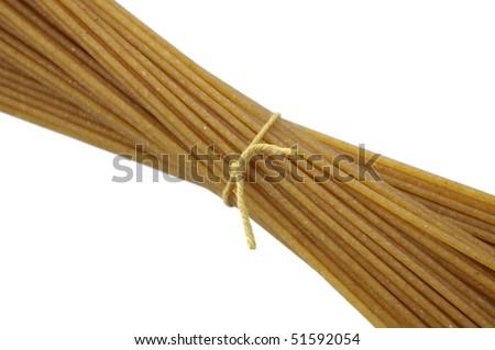 Whole grain pasta on white background - stock photo