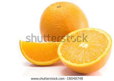 Whole, halved and quartered oranges, isolated on white. - stock photo