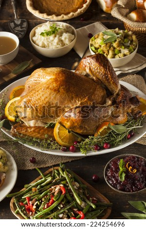 Whole Homemade Thanksgiving Turkey with All the Sides - stock photo