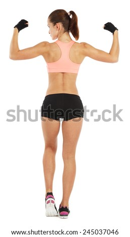 Whole length image of young sporty woman showing her biceps isolated on white - stock photo