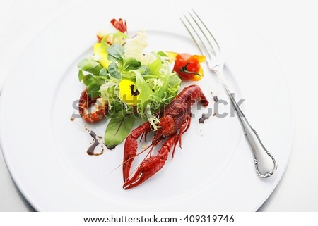 whole lobster with salad at expensive restaurant - stock photo