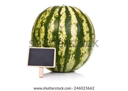 Whole melon with little empty blackboard, concept - stock photo
