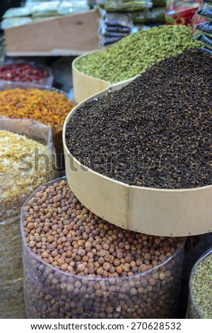 Whole middle-eastern spices displayed in the shop. - stock photo