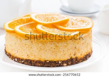 whole orange cheesecake, close-up, horizontal - stock photo