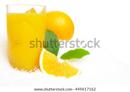 Whole orange with juice,ice cubes and leaves on snow on white background - stock photo