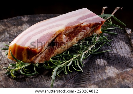 Whole piece of bacon, ready to be cut into cubes. Widely used in Italian cooking - stock photo