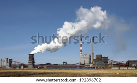 Whole plant with smoke and blue sky - stock photo