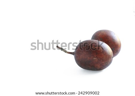 whole ripe fruit passion fruit on white background - stock photo