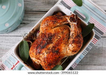 Whole roast chicken on grey background - stock photo