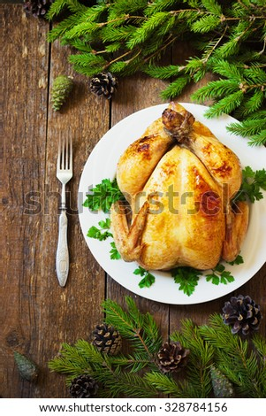 whole roast chicken on New Year's wooden table