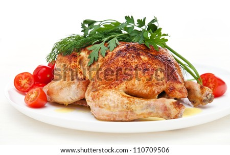 Whole roasted chicken with tomatoes and herbs on white background