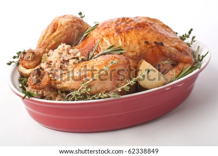 whole roasted stuffed turkey in a dish - stock photo