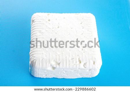whole soft cheese on dishware - stock photo