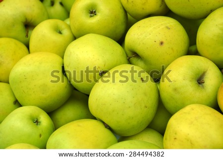 Whole tasty green apples at the market