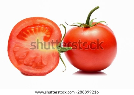 Whole tomato cut in half, isolated on white background