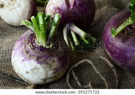 Whole turnips lying on the sackcloth   - stock photo