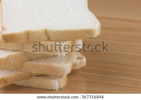 Whole wheat bread on wooden table.