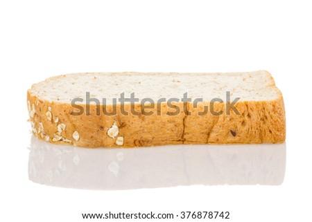 whole wheat bread slice isolated on white background. - stock photo