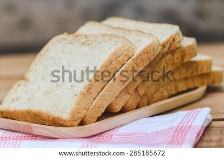 Whole wheat bread still life. - stock photo