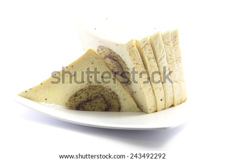 Whole wheat bread with banana ingredient on white plate and white background - stock photo