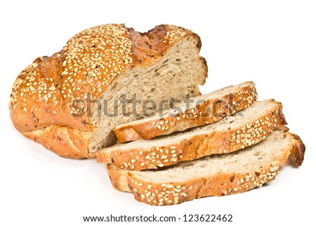 Whole wheat bread with sliced isolated on white background - stock photo