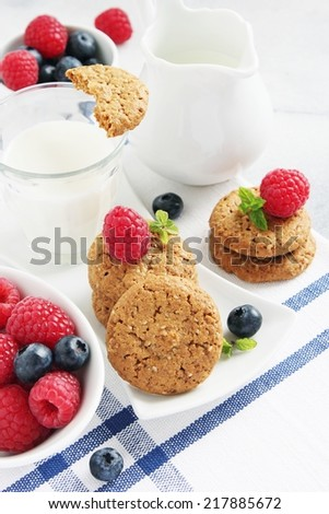Whole wheat cookies with milk and fresh berries.Selective focus.