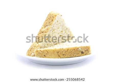 Whole wheat fresh bread sandwich sliced on white plate and white background