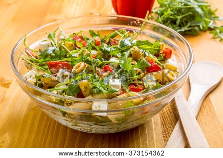 Whole Wheat Pasta Salad with Fresh Arugula, Mozzarella,  Roasted Red Bell Peppers and Pesto Sauce - stock photo