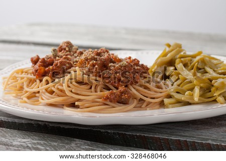 Whole wheat spaghetti with French style cut green beans side view - stock photo