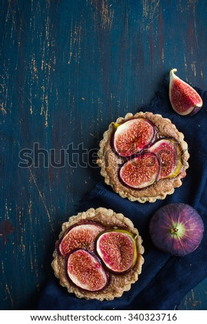 whole wheat tarts  with chocolate frangipane and figs, top view, copy space - stock photo
