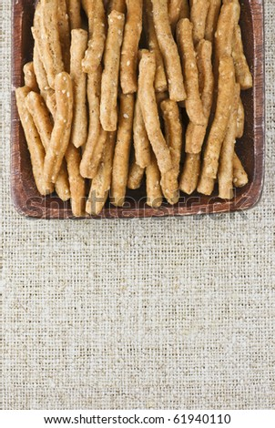 wholegrain sticks with sesame seed in wooden bwol - stock photo