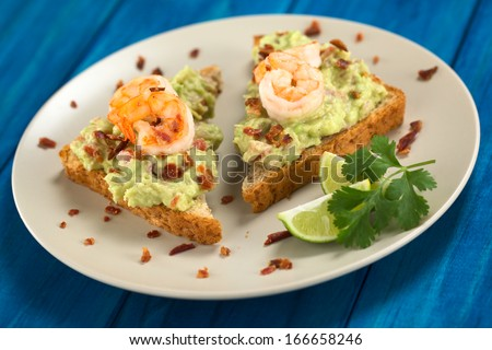 toast bread slices with guacamole, fried shrimp and fried bacon ...