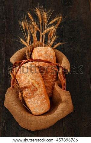 Wholemeal breads in a basket - stock photo