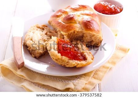 Wholemeal buns with marmalade and cup of tea